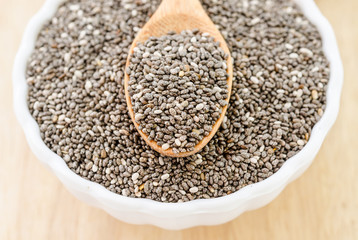 chia seeds with wooden spoon.