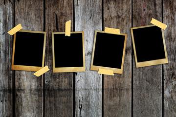 Old photo frame on wood background.