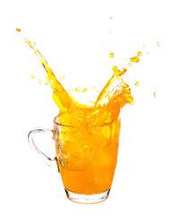 Splashing of orange juice with ice in glass on white background.