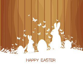 Easter greeting card with rabbit  on the wooden background