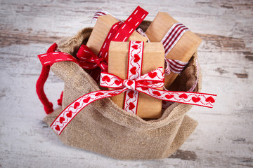 Wrapped gifts for Christmas or Valentines in jute bag