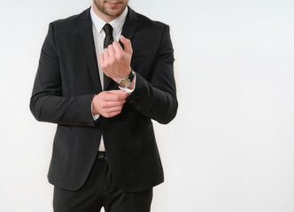 business man body side button up his black suit on white backgro