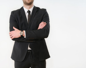 business man body side folded his arms in black suit on white ba