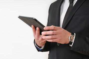 close up shot of business man hands holding a tablet on white ba