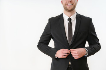 smiling business man body side button up his black suit on white