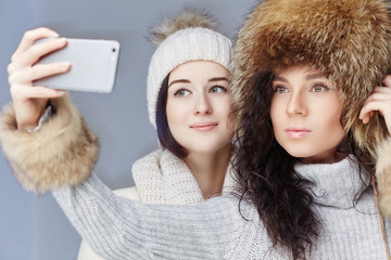 Two girl in winter clothes.