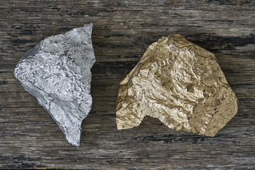 Gold and Silver ore on wood plate
