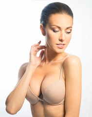 Young girl in a beige bra