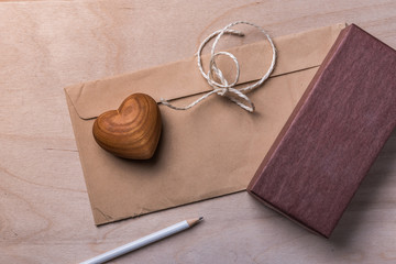 Old Love Letter with Wooden Hart and Package