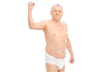 Semi-dressed senior flexing his bicep