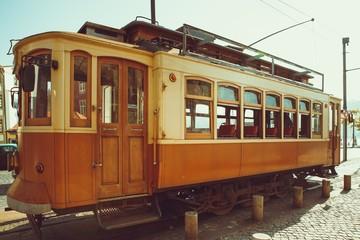 The old fashion Porto yellow streetcar.