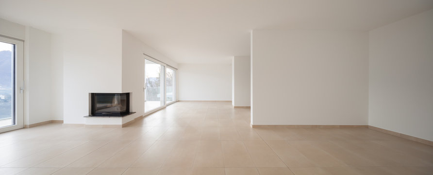 interior of new apartment, empty living room, tiled floor