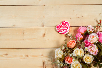 Roses flowers and empty space on wooden background