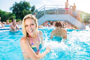 Beautiful couple in the swimming pool