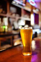 Pub Beer Glass on a Tavern Bar