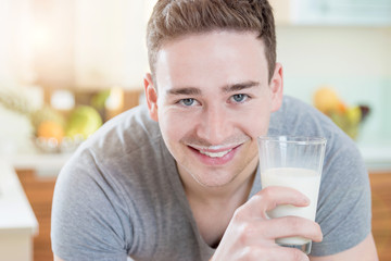 Smiling Man with a glass of Milk in the Morning Sun