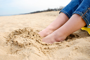 Female Feet in Sand at Beach