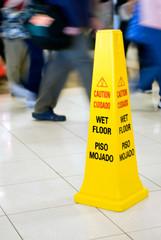 Photo of Wet Floor Sign with People Walking