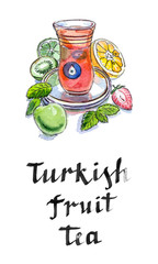 Turkish fruit tea in traditional glass cup with fresh fruit and