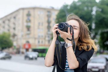 Tourists take pictures on her camera