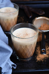 Carob Drink, Cocoa or Coffee Milk Drink on dark background