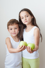 kids child muscles showing strength training apple boy girl