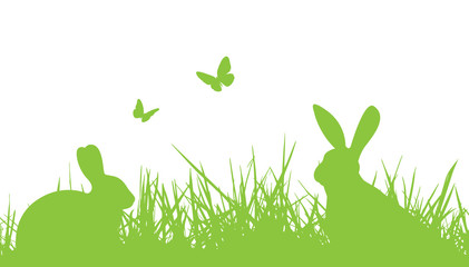 Wall Mural - easter silhouette bunnies in grass