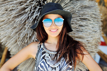 Fashion lifestyle portrait of young happy pretty woman in hat an