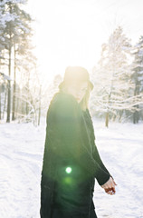 beautiful portrait of cute woman in winter forest
