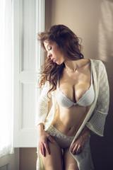 woman in lingerie in a window