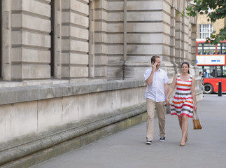Couple walking together on city street, London, United Kingdom