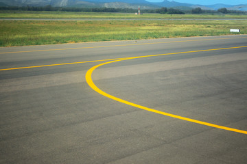 yellow line on an airport taxiway