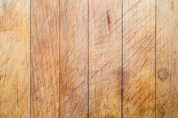 Rough wooden used cutting board background with vertical lines and cutting traces
