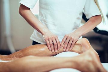 Sports Massage. Therapist massaging leg