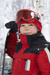 Caucasian boy wearing ski gear in snow