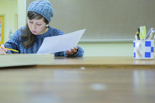 Hispanic student working in classroom
