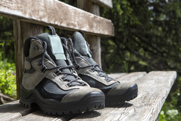 Grey hiking shoes on a bench