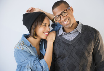 Portrait of smiling couple against white background