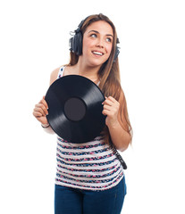 portrait of a girl holding a vinyl listening to music