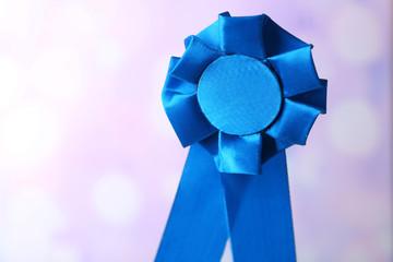 Award ribbon on light background