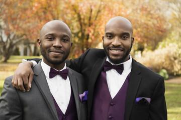Black groom and best man posing at wedding