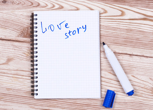 Book writing love story  and pen