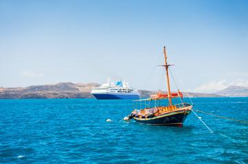 Tourist boat and cruise ship on the sea coast