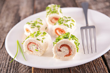 canape, bread rolled up with salmon and cheese