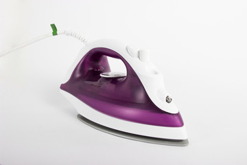 Purple steam iron isolated on white background