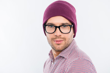 Close up photo of handsome man in violet cap and glasses