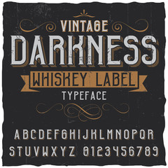 Whiskey label font and sample label design with decoration and ribbon. Vintage font. Whiskey font. Fine label font. Handcrafted font. Decoration font. Font style. Retro font. Old font. Stylized font.