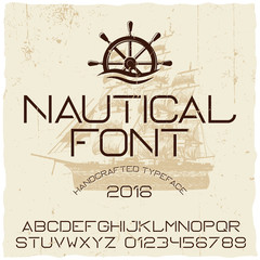 Nautical hand crafted typeface with vector ship on background.