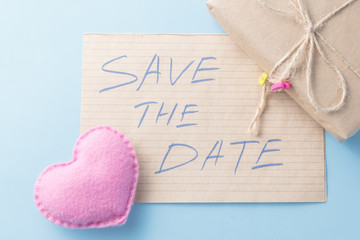 Soft toy heart and message save the date.