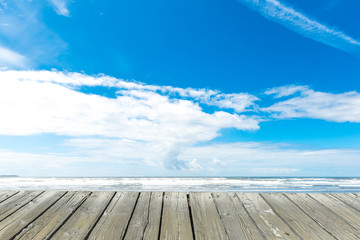 empty wooden deck table top Ready for product display montage with blue sky background.